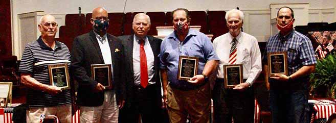 Veterans honored, from left, Bob Craker, Chris Walker, First Assembly Pastor Don Davis, Paul Chason, Jack Wright, and Charles Wilson.